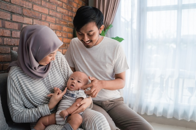 Happy muslim family with a cute baby