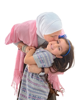 Happy muslim woman and daughter