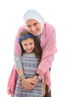 Happy muslim woman and girl