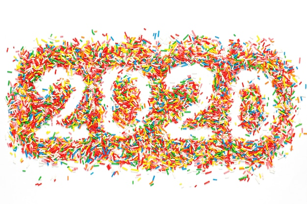 Happy new 2020 year. colorful number shape with bright rainbow sugar sprinkles isolated on white