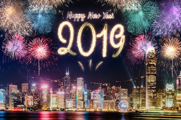 Happy new year 2019 firework over cityscape building at night time celebration
