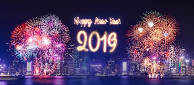 Happy new year 2019 firework over cityscape