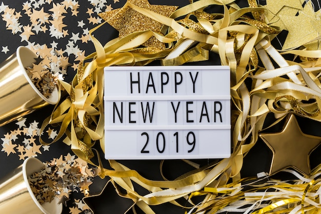 Happy new year 2019 inscription on board with spangles