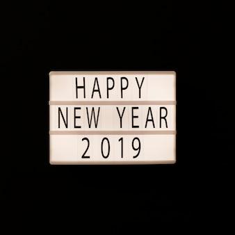 Happy new year 2019 inscription on light board