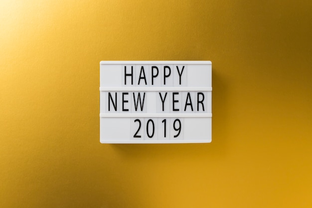 Happy new year 2019 inscription on white board