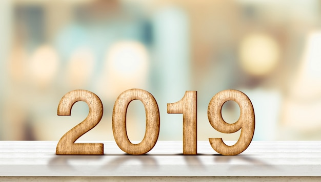 Happy new year 2019 on marble table with pale soft bokeh wall