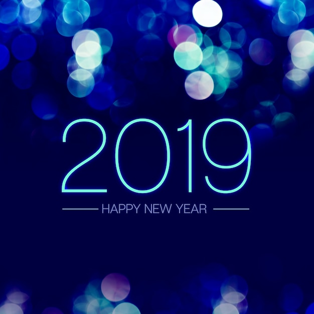 Happy new year 2019 with blue bokeh light sparkling on dark blue purple background
