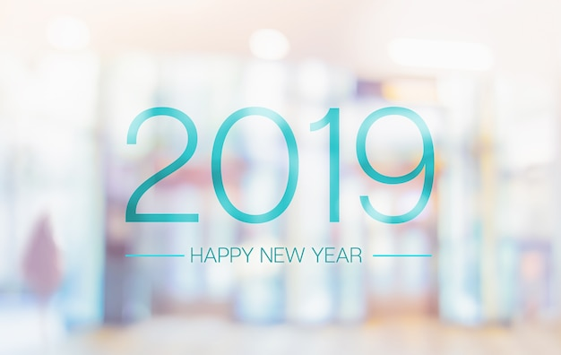 Happy new year 2019 word on blur pale color convention hall office building bokeh