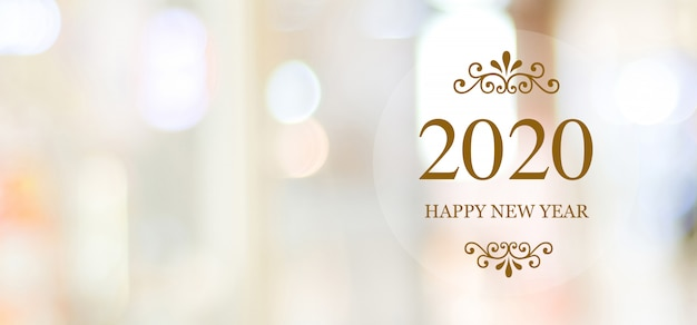 Happy new year 2020 on blur abstract bokeh background