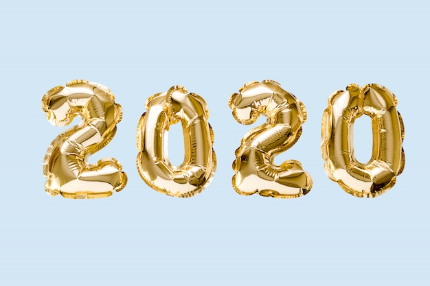 Happy new year 2020 celebration. gold foil balloons numeral 2020 isolated on blue background