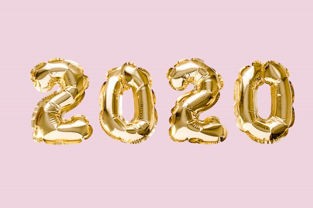 Happy new year 2020 celebration. gold foil balloons numeral 2020 isolated