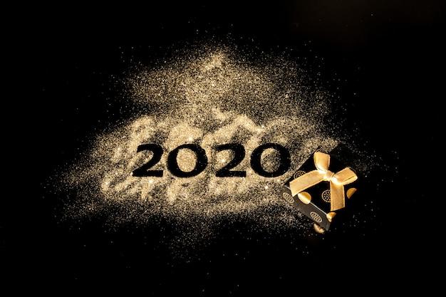 新年あけましておめでとうございます2020。数字2と0の創造的なコラージュは2020年を構成しました。黒に美しい輝く黄金の数2020