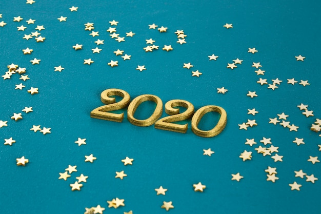 Happy new year 2020. creative text happy new year 2020 written in gold wooden letters.