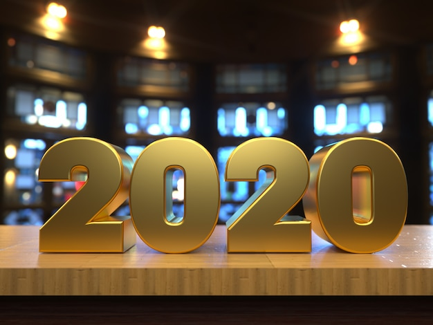 Happy new year 2020 golden text over a wooden table