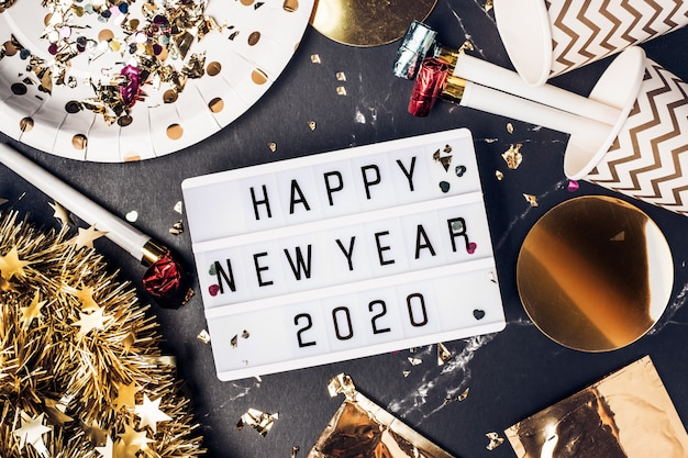 Happy new year 2020 on light box with party cup