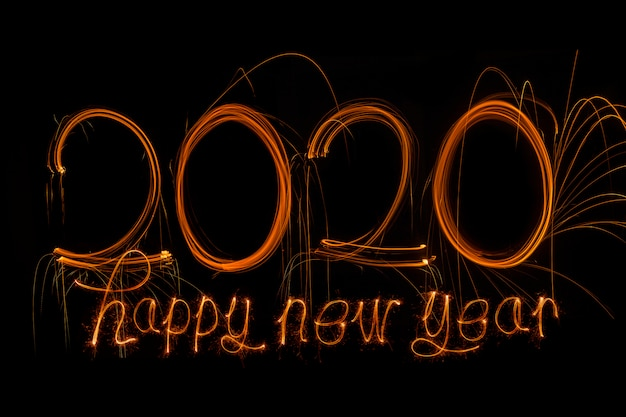 Happy new year 2020. number 2020 written sparkling sparklers