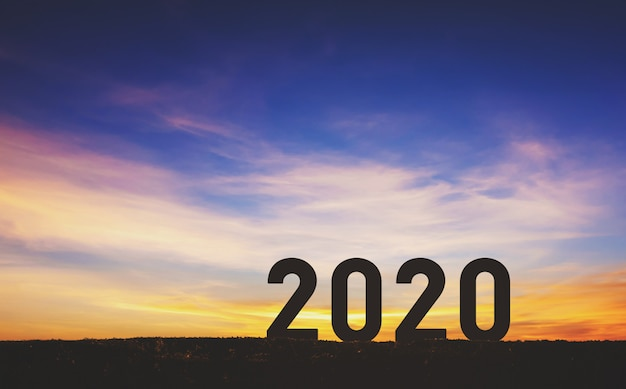 Happy new year 2020, number silhouette over sky