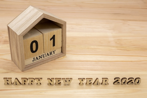 Happy new year 2020 and wooden house calendar