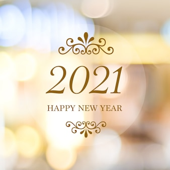 Happy new year 2021 on blur abstract bokeh background, new year greeting
