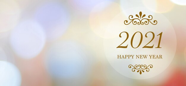 Happy new year 2021 on blur abstract bokeh background with copy space for text, new year greeting card, banner