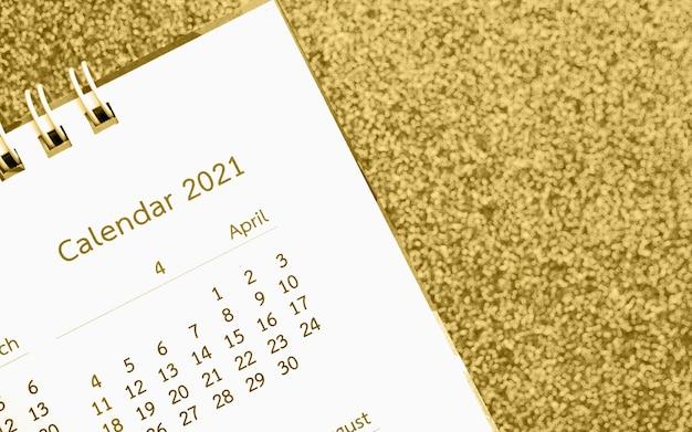 새해 복 많이 받으세요 2021 달력 페이지가 골드 반짝이 스파클에 닫습니다.
