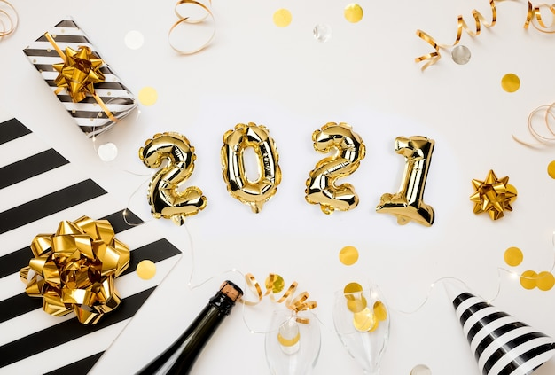 Happy new year 2021 celebration. golden number ballons with gifts