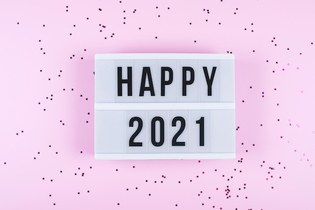 Happy new year 2021 celebration. light box with text happy 2021 and sparkles
