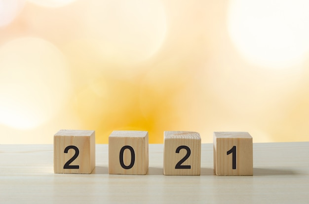 Happy new year 2021 creative ideas cubes on wooden tables