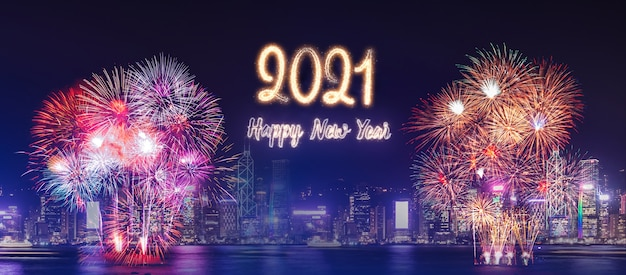 Happy new year 2021 firework over cityscape building near sea at night time celebration