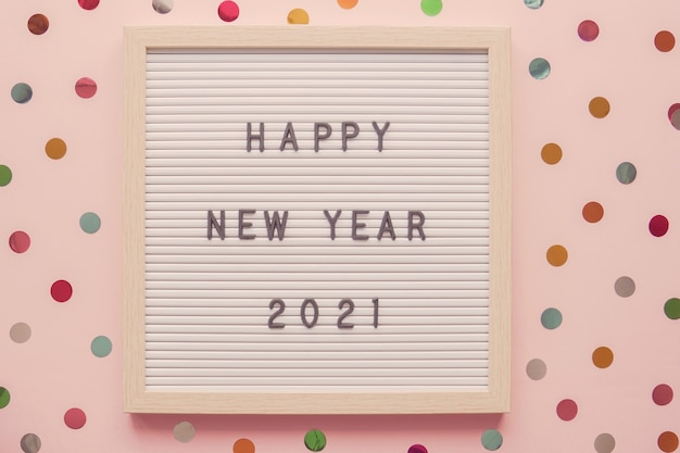 Happy new year 2021 on letter board with colorful dot pink pastel background