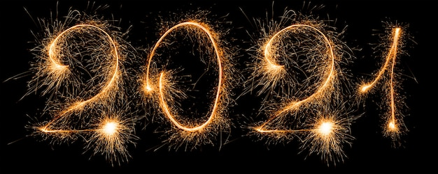 Happy new year 2021. number 2021 written sparkling sparklers isolated on black background with copy space for text.