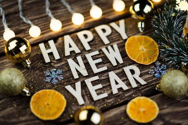 Happy new year 2021 on wooden background