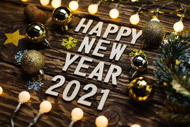 Happy new year 2021 on a wooden table