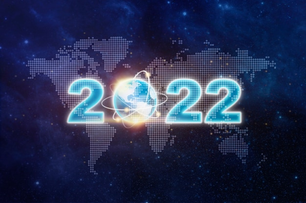 2022년 새해 복 많이 받으세요 그리고 밤하늘에 날아간 별의 세계 지도 위의 지구 표지판은 세계 경제, 사업 계획, 2022년 비즈니스 성장 개념을 보여줍니다. 세계 지도, 별, 공간에 새해 복 많이 받으세요 2022 텍스트 디자인
