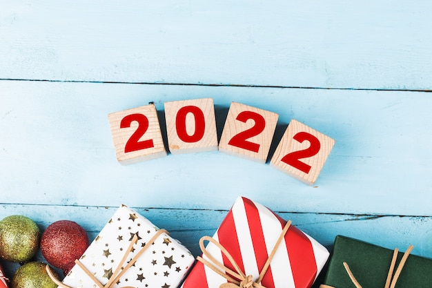 Happy new year 2022 christmas 2022 christmas gifts placed in a festive atmosphere,