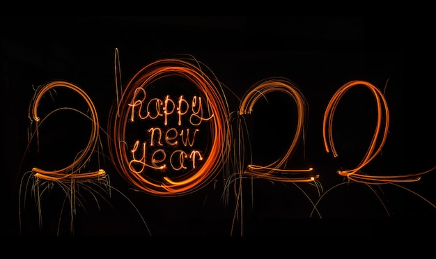 Happy new year 2022 sparkling burning text happy new year 2022 isolated on black background