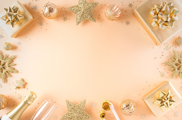 Happy new year celebration background concept. golden gift box, stars, christmas ball and champagne