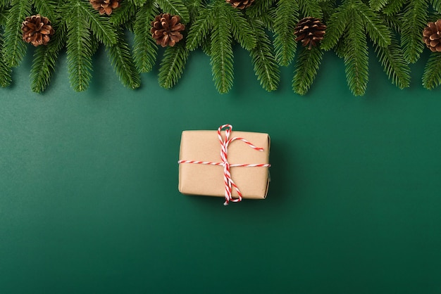 Happy new year christmas day concept top view flat lay fir tree branches gift box and decoration