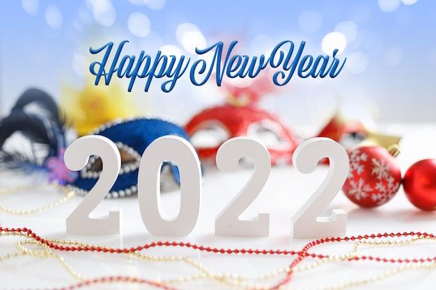 С новым годом концепция с числами 2022 на фоне боке