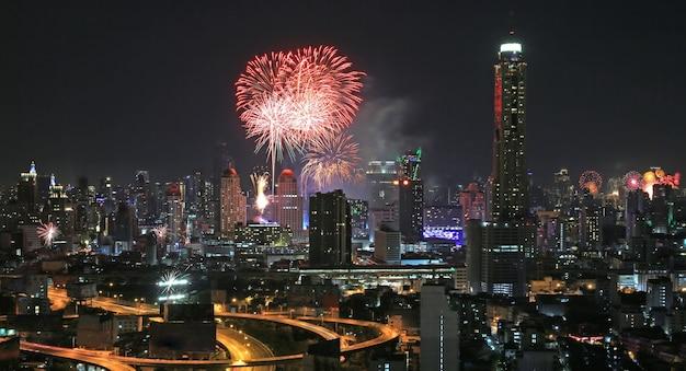 Happy new year and firework at bangkok central city, thailand.