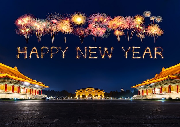 Happy new year fireworks over chiang kai-shek memorial hall at night in taipei, taiwan