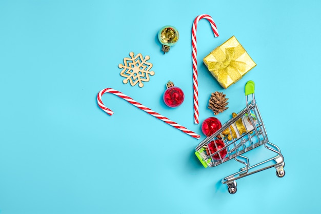 Happy new year, flat lay composition, place for text christmas decor on blue color backgro