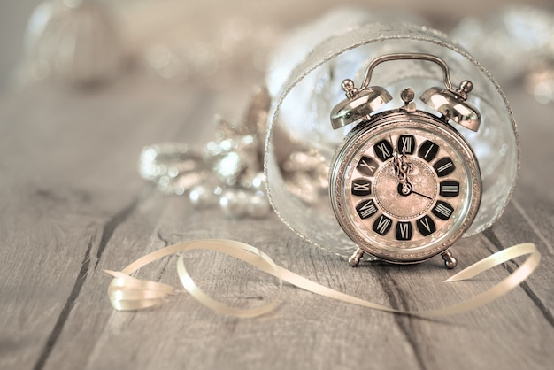 Happy new year! greeting card with vintage alarm clock
