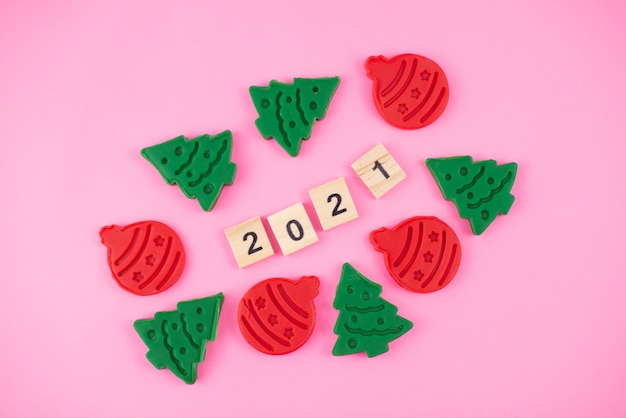 Happy new year and merry christmas. scrabble letters, playdough and plasticine. letter tiles spelling celebration holiday.