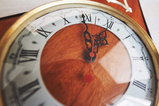 Happy new year at midnight, old wooden clock