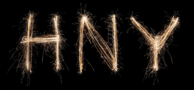 Happy new year sparkler light drawn in letters at night time to celebrate special holiday
