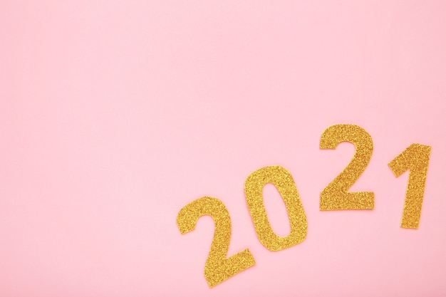 Happy new year symbol from number 2021 on pink background
