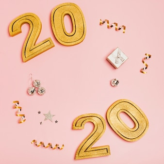 Happy new year with numbers 2020 on pink background