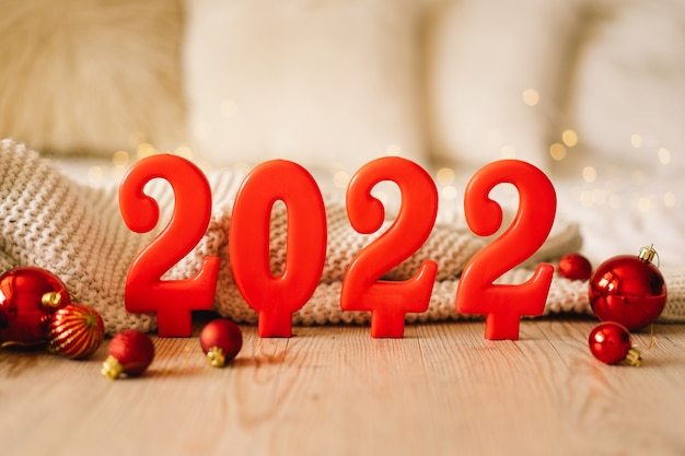 Happy new years  numbers of year  made by red candles on bokeh festive sparkling background