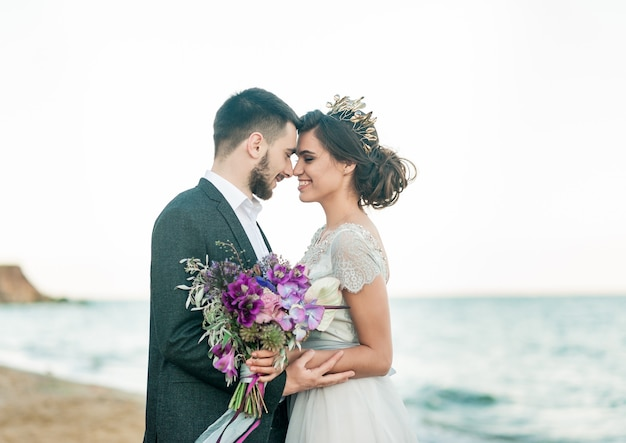 Happy newlyweds with a bouquet of flowers
